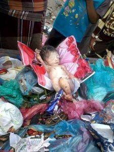 09 03 14 171228809 225x300 العثور على طفلة مرمية وسط أكوام القمامة بتعز – صورة